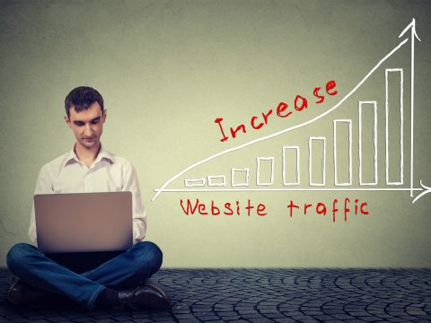 man using laptop working on a plan to increase website traffic. Technology marketing concept